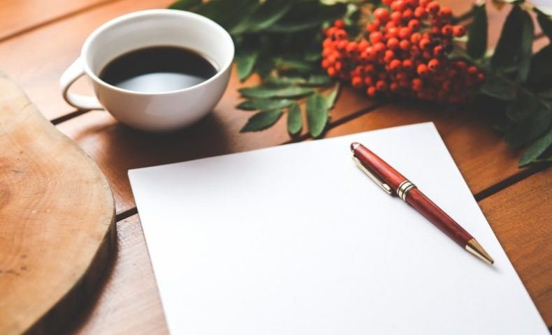 blank-paper-ballpen-and-coffee-cup-on-wooden-table