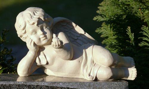 figurine-of-angel-holding-bird